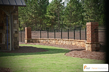 Custom Arched Entryway Iron Fence Panel On Brick Pillar